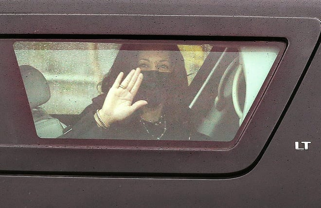 Vice President Kamala Harris waves from her motorcade to people gathered on Dyer Street in Providence on Wednesday.