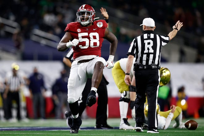 Alabama defensive lineman Christian Barmore (58) celebrates a sack against Notre Dame during the College Football Playoff Semifinals at the Rose Bowl Game presented by Capital One at AT&T Stadium on January 1, 2021 in Arlington, Texas. (Tom Pennington/Getty Images/TNS) ORG XMIT: 14657297W