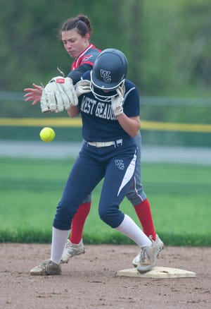 Kiera Williams beats the tag attempt by Shelby Long as West Geauga beat Crestwood 3-2.