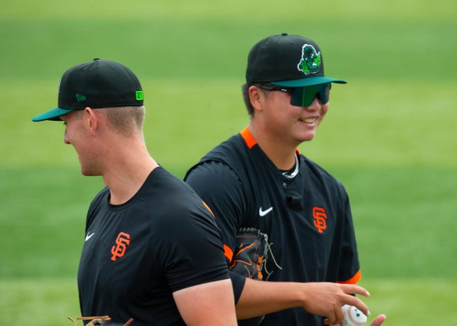 Pitchers Nick Morreale, left, and Kei-Wei Teng work out at PK Park before the start of the Eugene Emeralds' 2021 season.