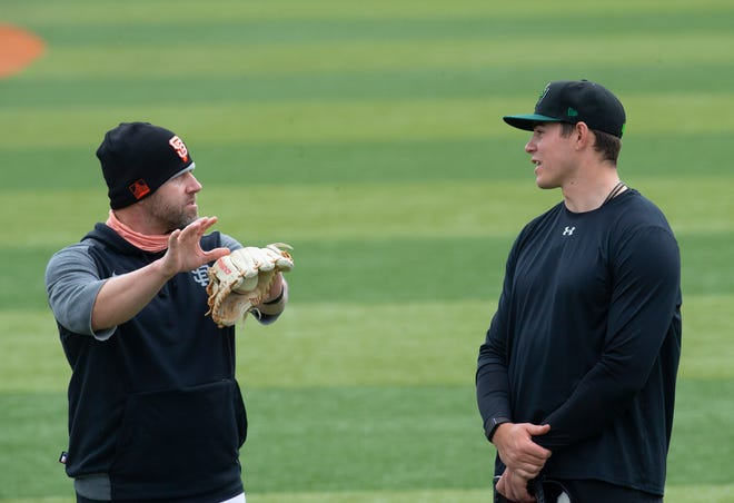 Eugene Emeralds manager Dennis Pelfrey, left, talks to starting pitcher Seth Corry during Saturday's practice at PK Park.