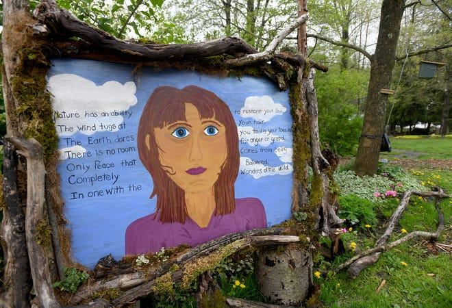 """""""Art in Bloom"""" opened recently at Beech Creek Botanical Garden & Nature Preserve in Washington Township. The exhibit features artwork, including this mural created by Kathy Roesti, the head gardener."""