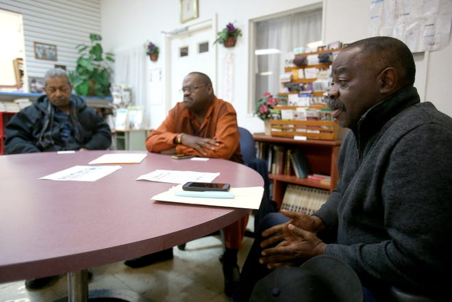 Local pastors (from left) Raphael Cox, Walter S. Moss, and Michael Pressley discuss the upcoming Community Gun Buyback, part of Stark County Prosecutor Kyle Stone's Safer Streets Initiative.