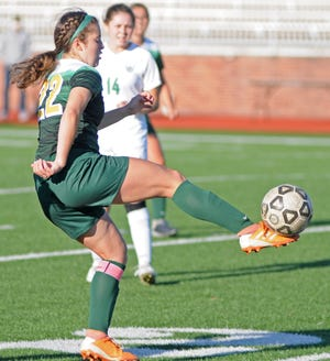 Salina South's Madalyn Crow kicks the ball up field during a May 4 game against Derby. Crow was a second team Class 5A all-state selection by the Kansas High School Soccer Coaches Association.