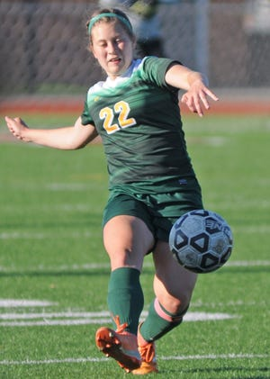 Salina South's Madalyn Crow kicks the ball during the first half of the game against Derby at Salina Stadium on Tuesday.