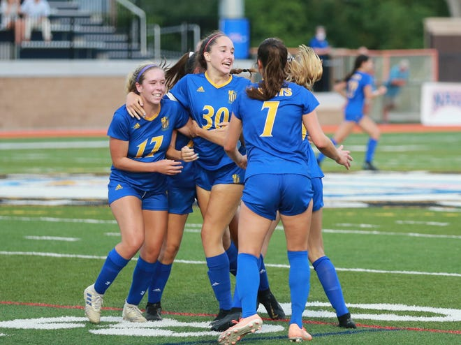 St. Vincent's Academy's Emma Beddow celebrates with teammates after scoring a game-tying goal in the second half of a GHSA Class A Private state playoff game Tuesday at Memorial Stadium.