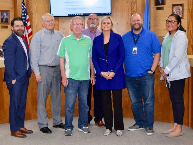 Dr. April Grace was recognized at the May Shawnee Board of Education meeting for receiving the OASA District 9 Superintendent of the Year Award. Pictured are, from left, Clif Harden, Larry Walker, Bobby Canty, Keith Sandlin, Dr. April Grace, Ian Brown and Kristen Wilson.