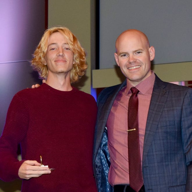 Aiden Grein (left) and Band Director Ryan Henigman (right) at the SHS Band banquet. Grein received the John Philip Sousa Award, the highest award given to a high school band student.