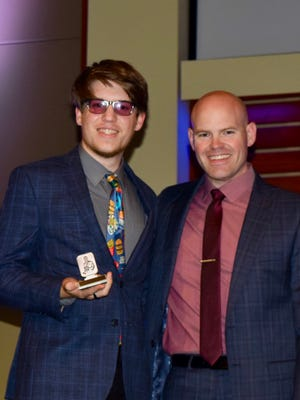 Levi Wilson (left) and Band Director Ryan Henigman (right) at the SHS Band banquet. Wilson received the Louis Armstrong Jazz Award.