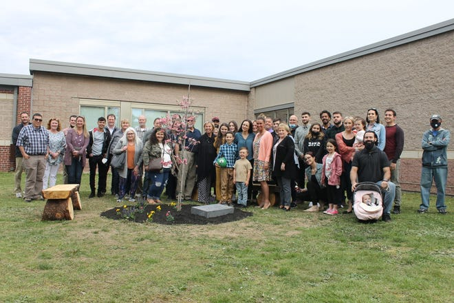 Friends, family and community members gathered for the tree ceremony.