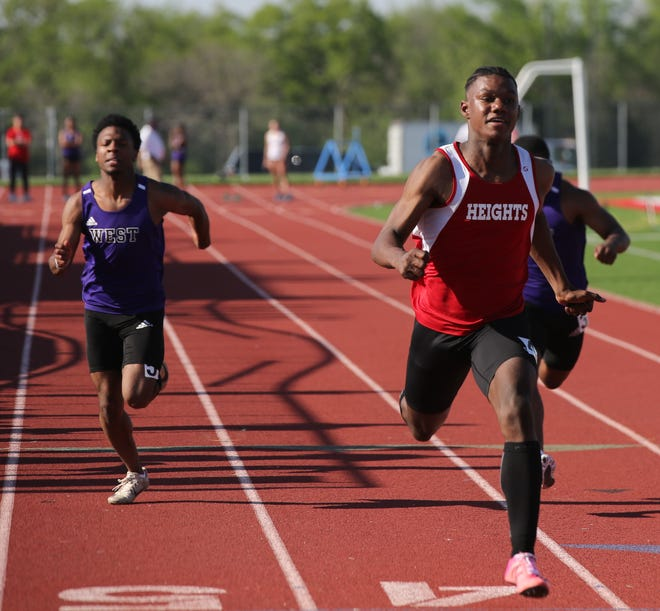Shawnee Heights' Jeremiah Smith (right) returned after missing two weeks with two wins at Thursday's Class 5A track and field regional at Mill Valley. Smith won the 100 and 110 hurdles and took second in the 200.
