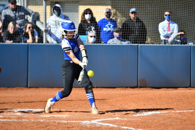 Washburn Rural sophomore Kaci Bath belts a three-run home run during Tuesday's first game against Seaman, powering the Junior Blues to a 5-2 win. Rural added four home runs in a 14-6 win in the nightcap.