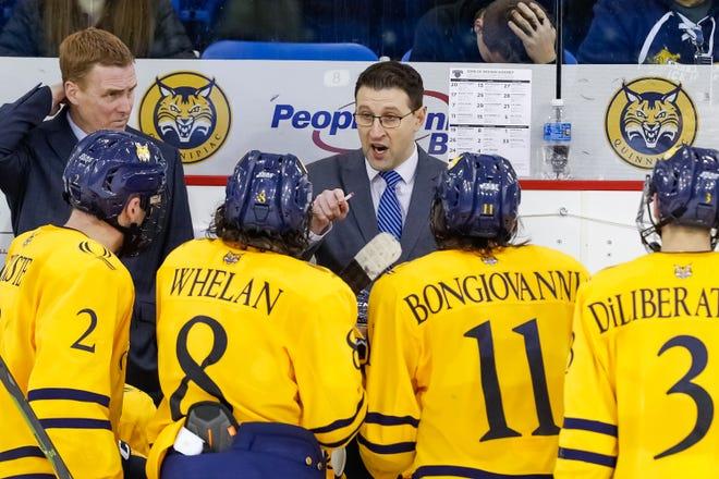 New Holy Cross men's hockey coach Bill Riga addresses players as an assistant coach at Quinnipiac last season.