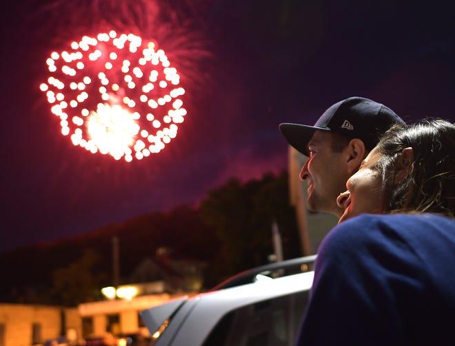 People watch Worcester's fireworks display from Shrewsbury Street in 2019.
