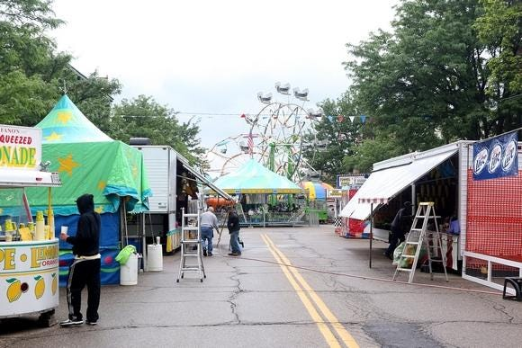 Vendors wrap up preparations for the Canal Dover Festival in 2015.