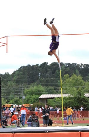 Ozark junior Britton Gage competes in the pole vault event at Tuesday's Class 4A state track meet in Nashville. Gage won the event with a measurement of 14 feet, 6 inches.