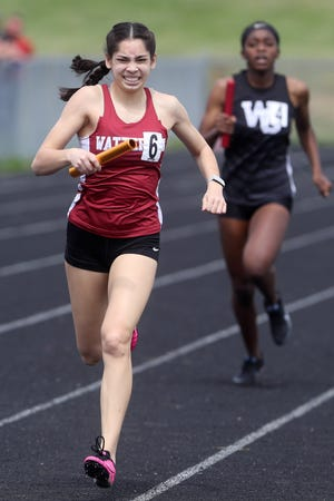 """Watterson senior Anna Kessler is not only the daughter of girls track coach Adam Kessler, she is one of the team's top competitors. """"I've done a really good job of keeping expectations realistic, and with Anna, one of her best attributes is being able to separate me as father and coach,"""" Adam said."""