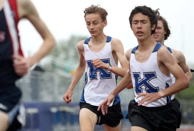 Kilbourne's Ryan Smith (center) and Stephen Tice compete in the 1,600 meters during a home dual meet against Thomas on May 4. Smith's goal for the race was to help Tice finish in under 5 minutes, and Tice placed fourth in a personal-record4:59.89.