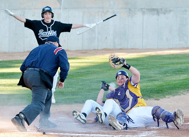 Post 17 catcher Braxton Lacher shows home-plate umpire Matt Clark that he still has possession of the ball after tagging out Aberdeen base runner Nick Clemens during the first game of their American Legion baseball doubleheader Tuesday night at Watertown Stadium. Looking on is Aberdeen's Austin Wagemann.