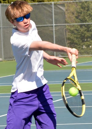 Curtis Sneden of Watertown hits a return shot Tuesday during a high school boys tennis dual against Aberdeen Roncalli at the Highland Park Courts.