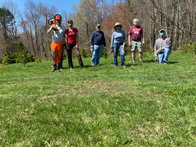 Friends of Steele Farm paused after weeding and mulching the Christmas trees