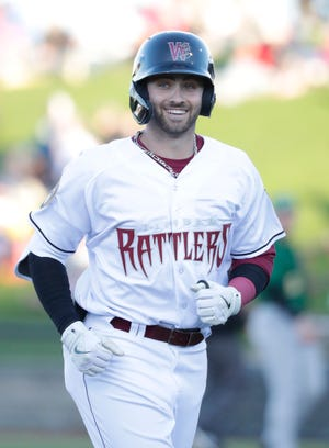 Timber Rattlers outfielder Garrett Mitchell (5) smiles as he heads back to the bench during the May 4 season opener at Fox Cities Stadium.