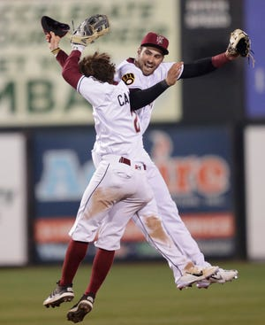 Wisconsin Timber Rattlers Garrett Mitchell and Hayden Cantrelle (2) celebrate after turning the game-winning double play against the Beloit Snappers in the season opener Tuesday in Grand Chute.
