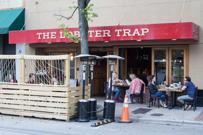 People dine at the Lobster Trap in downtown Asheville April 20, 2021. Almost a year after mask mandates were imposed, Buncombe County is aligning with state and federal guidance, lifting mask requirements in most settings and ending social distancing and gathering limits.