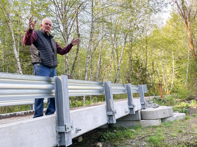 Frank Stricklin describes the way young Coho salmon can now make their way to a vast wetland in Newberry Hill Heritage Park, thanks to volunteers' efforts to bring a bridge to one of the trails.