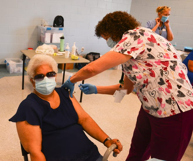 The Florida Department of Health on Wednesday began offering COVID-19 vaccines to residents age 18 and up at libraries and community centers throughout Brevard County. Maria Maisonet gets her Johnson and Johnson vaccination from Kathie Simmons, R.N. at the Wickham Park Senior Center Wednesday.