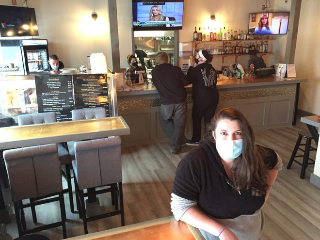 Alex Morano, owner of The Food Bar, stands April 21, 2021 in the dining room of the restaurant in Essex Junction.