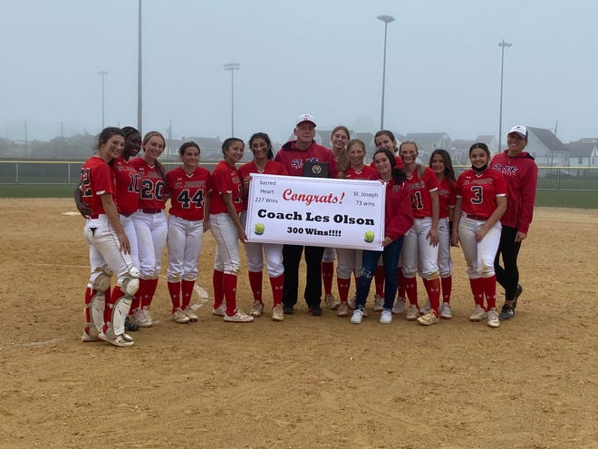 The St. Joseph Academy softball team honors its coach Les Olson after he earned his 300th career win on Wednesday with a 6-0 triumph in Ocean City.