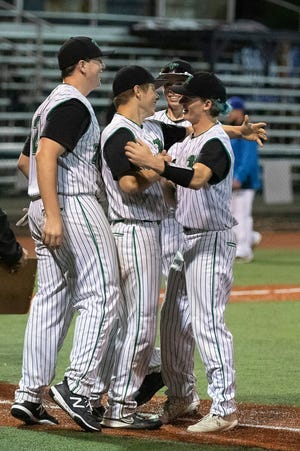 The Huntington Huntsmen celebrate their 8-6 win over Chillicothe at the VA Memorial Stadium on May 4, 2021, in Chillicothe, Ohio.