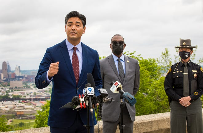 Aftab Pureval, Hamilton County clerk of courts, holds a press conference, May 5, 2021, at Olden View Park in East Price Hill, to talk about the mayor's race. Pureval was the top vote getter in the May 4th mayoral primary. David Mann was second. One of them will be the next Cincinnati mayor. Supporting Pureval was former Mayor Mark Mallory and Hamilton County Sheriff Charmaine McGuffey