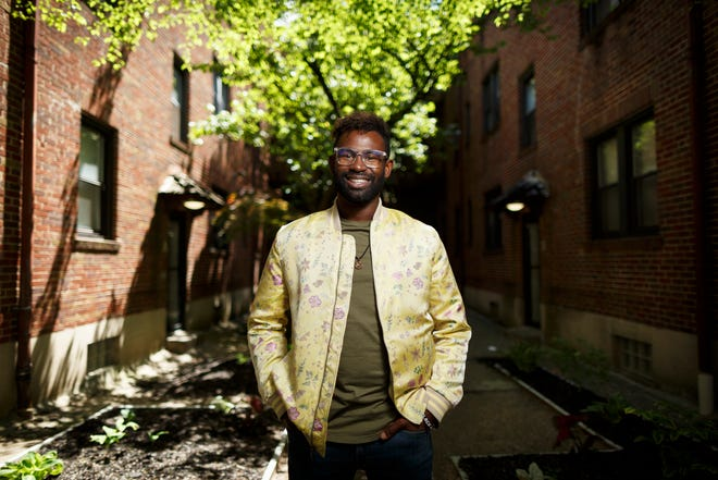 """Darnell Pierre Benjamin, director of the film """"13th & Republic,"""" poses in a courtyard near his home in the Clifton Heights neighborhood of Cincinnati on Wednesday, May 5, 2021."""
