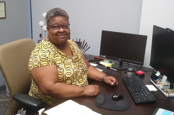 Karen Jones, mental health program manager for Sunrise Treatment Center, sits at her desk in the Forest Park office. She says Sunrise is a great place to work. Sunrise is recognized as the midsize company for 2021 by Top Workplaces Cincinnati.
