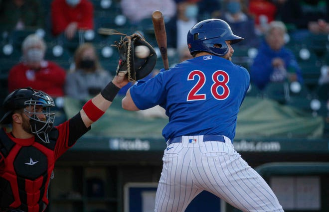 Iowa catcher Taylor Gushue holds on a ball high in the second inning against Indianapolis at Principal Park in Des Moines on Tuesday, May 4, 2021.