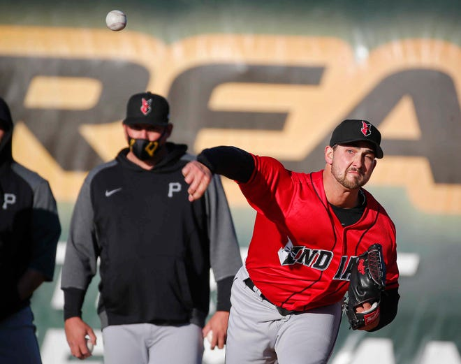 Indianapolis pitching coach Joel Hanrahan, left, who graduated from Norwalk and played professionally from 2001-2013, overlooks starting pitcher Chase De Jong prior to the start of the game against the Iowa Cubs at Principal Park in Des Moines on Tuesday, May 4, 2021.