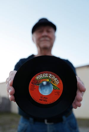"""Kenny Folcik, keyboard player and original member of the popular '60s/'70s rock band Rare Earth, displays a copy of his hit single """"Get Ready."""" He is currently a member of the band The Collective."""