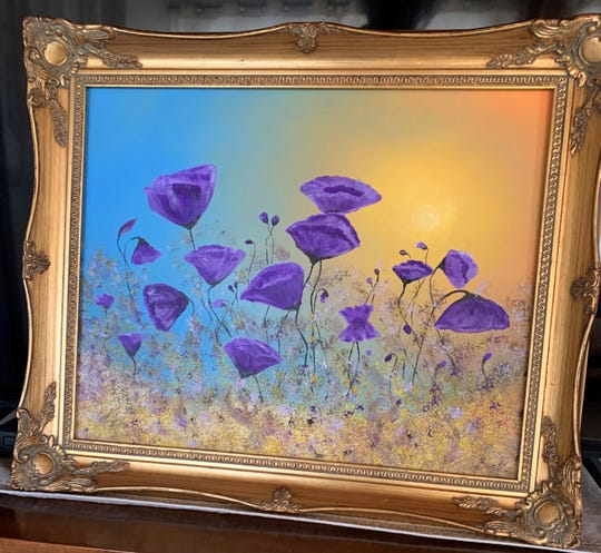 """This dreamlike painting of purple poppies in a golden field by Terry Lundahl of Sturgeon Bay, who'd never taken up painting until she went through a series of unfortunate events last year, recently was bought for use on the upcoming Spectrum Originals cable TV show """"Joe Pickett."""""""