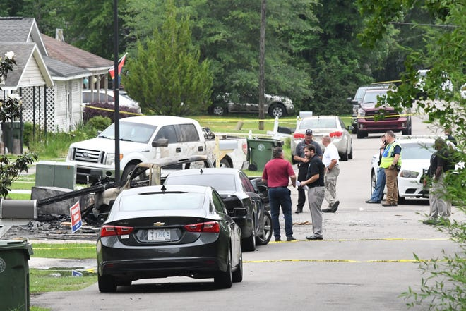 Emergency responders on Wednesday, May 5, 2021, investigate the scene of a plane crash in Hattiesburg, Miss., in which four people were killed Tuesday, May 4, 2021.