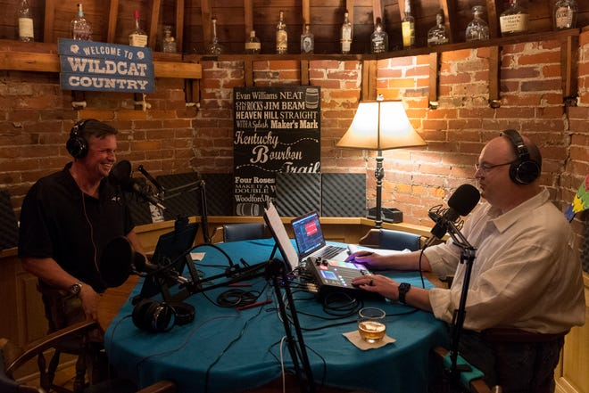 """Local attorney Curt Hamilton, left, is interviewed by host Brent Bridges, right, for the new podcast """"612 N. Main"""" at Bridges' home in Downtown Henderson, Ky., Friday afternoon, April 30, 2021."""