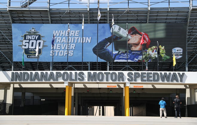 A photo of IndyCar driver Takuma Sato celebrating after he won the 2020 Indianapolis 500 is unveiled Wednesday, May 5, 2021, above gate 2 of Indianapolis Motor Speedway.
