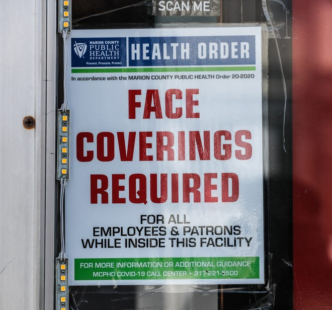 A Marion County Public Health Order Hangs in a Business Window Wednesday, May 5, 2021 in Broad Ripple Village, Indianapolis