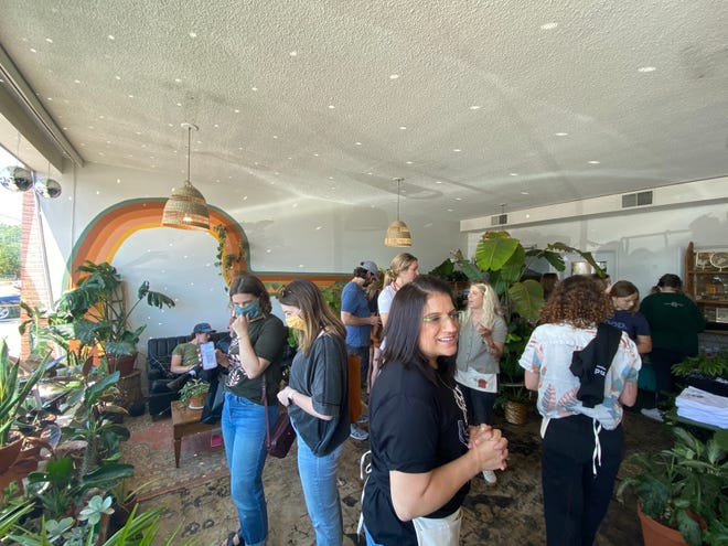 Crowds happily browse through the sparkling plant selections on Grounded Plant Company's opening day.