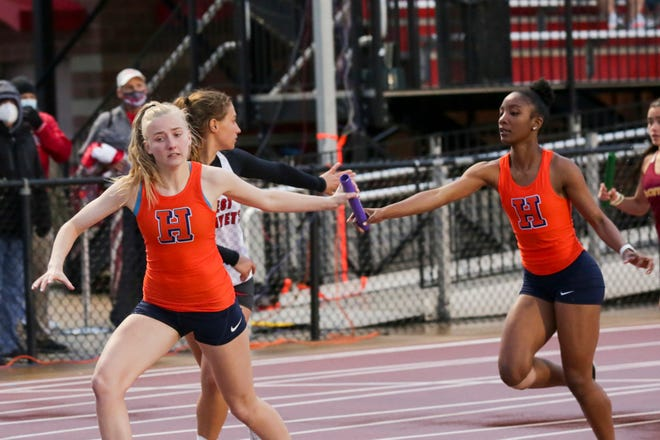 Harrison's Jada-Marie Davis, Caitlin Williams, Chloe Poindexter and Jaylie Lohmeyer compete in the girls 4x400 meter relay during the City County track meet, Tuesday, May 4, 2021 in Lafayette.