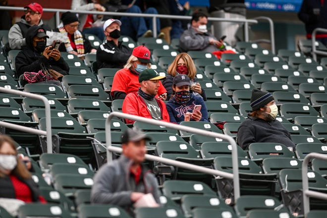 Fans take in the Lansing Lugnuts opening night baseball game against the Lake County Captains on Tuesday, May 4, 2021, at Jackson Stadium in Lansing.