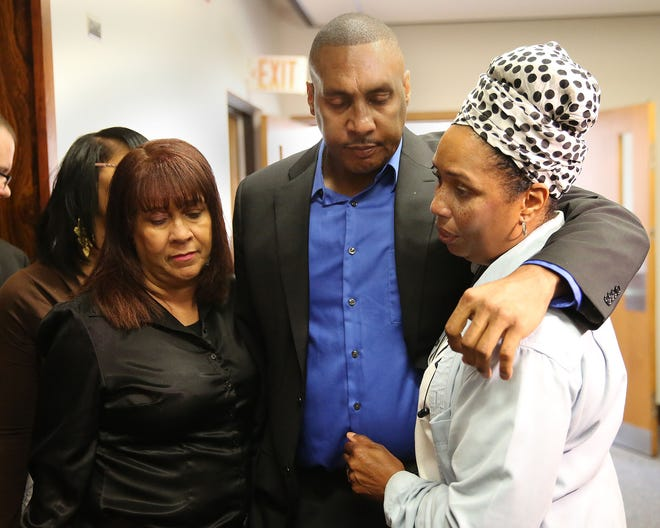 """Claude Motley, center, is surrounded by his sisters after the sentencing of Nathan King on July 16, 2015. King, 15, himself paralyzed from a shooting, was sentenced to prison for shooting Motley in an attempted carjacking. The case, and Motley's journey, are the focus of a new documentary, """"When Claude Got Shot."""""""