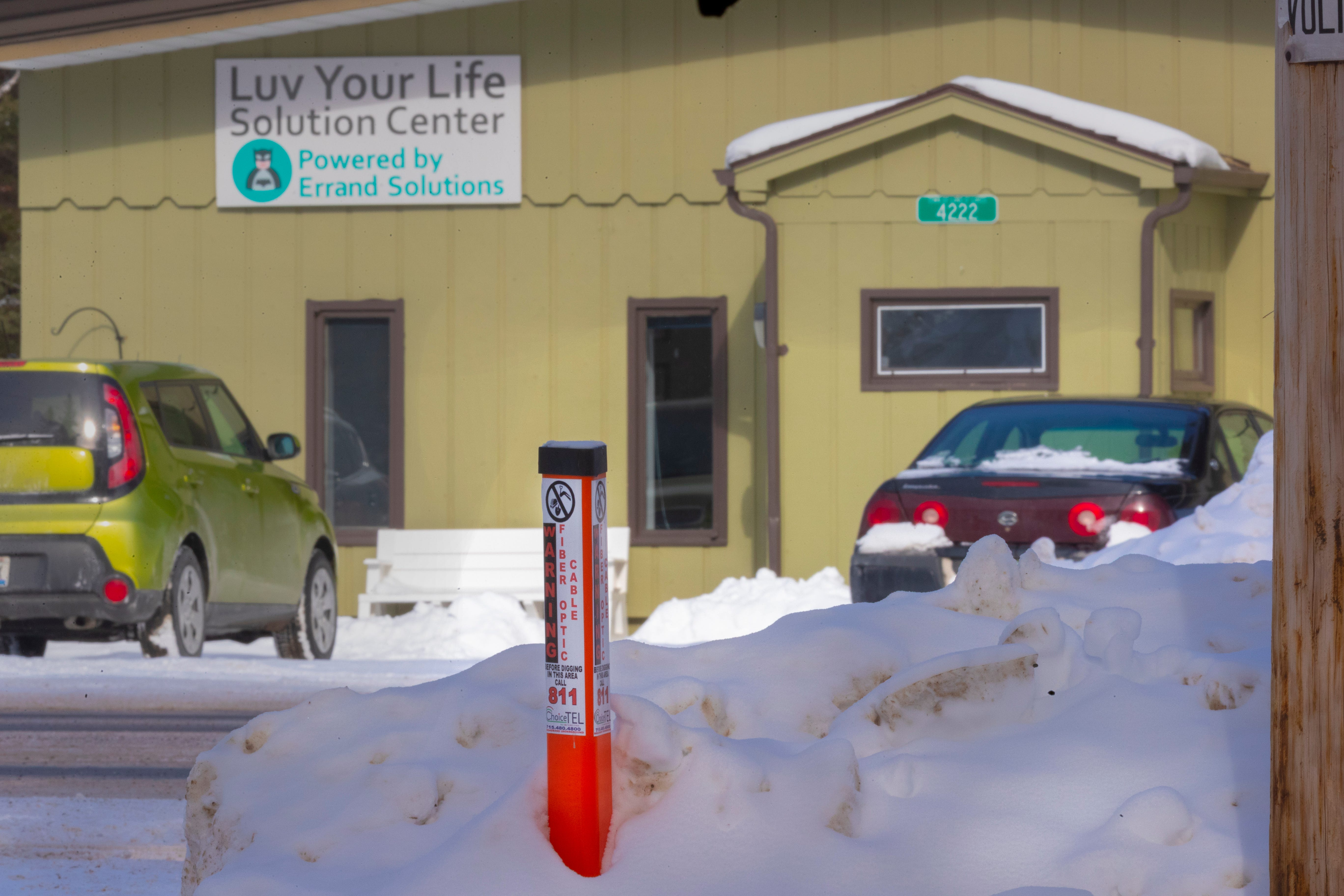 A marker for the fiber optic line is shown about 100 feet from the Luv Your Life Solutions Center in Land O' Lakes.