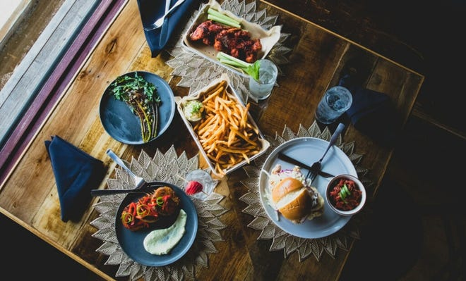 Blackwood Brothers Restaurant and Social Club, 3001 S. Kinnickinnic Ave., serves dishes such as black bean medallions with polenta, fried chicken sandwich with cabbage, skinny fries and Korean chicken wings on its custom-built tables.